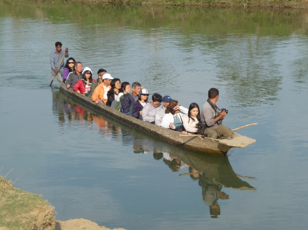 A canoe trip in crocodile infested waters of the Rapti, Chitwan, Nepal.