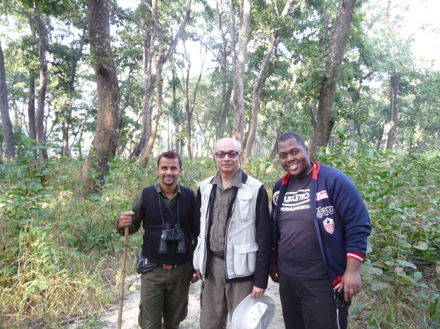 The author (center) with the tour guide and another hiker during the jungle walk.