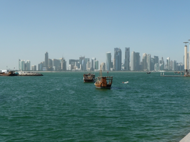 Corniche skyline skyline and dhows Doha
