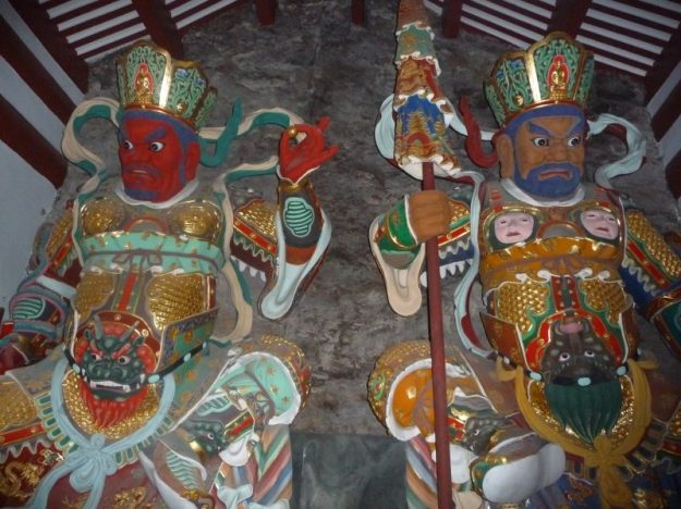Colorful statues on the sides of the steps to the Guanyin temple