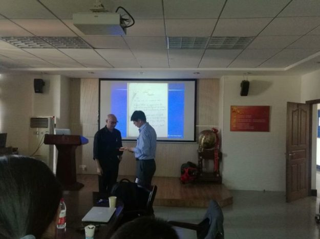 Presenting a book to the Wenzhou University library