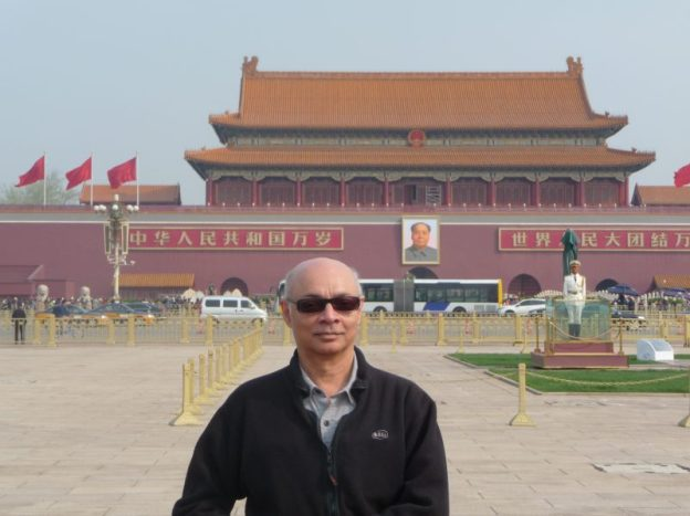 In Tiananmen Square under Mao's portrait, Beijing