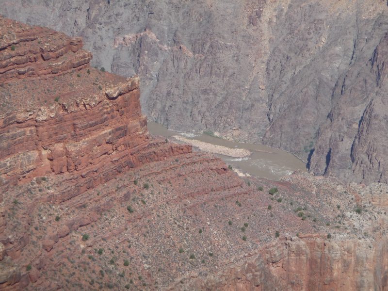 The thin stream of the Colorado river, a mile down from the South Rim.